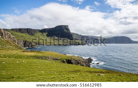 Seashore cliffs surrounding an ocean bay at Neist Point, Isle of Skye, Scotland #516612985