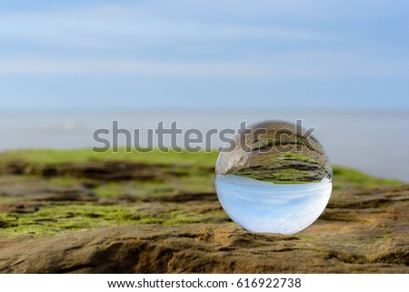 Seashore is reflected inside the crystal ball #616922738