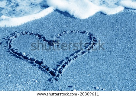 Seashore with surf line making heart shape