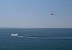 seaside parasailing on background of sea and sky