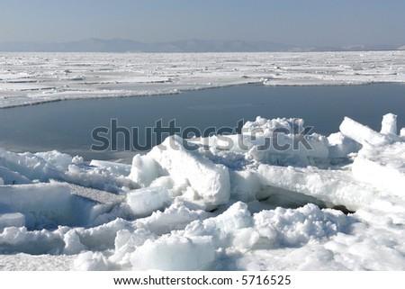 Seaside  region,     Russia Winter, ice on sea ,  City(town) Vladivostok - stock photo