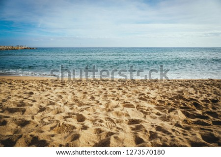 Seaside view with Golden Sand and Blue Sky in Barcelona, Spain #1273570180