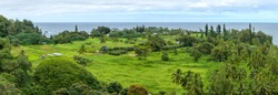 Seaside Village - A panoramic view of a tropical seaside village at Keanae Peninsula of east Maui, as seen from the Road to Hana Highway, on a cloudy afternoon. Hawaii, USA.