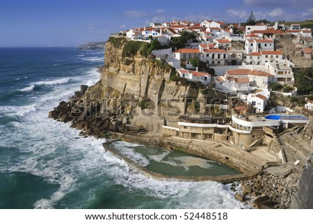Seaside village on a cliff overlooking the ocean in Sintra, Portugal. Horizontal shot.