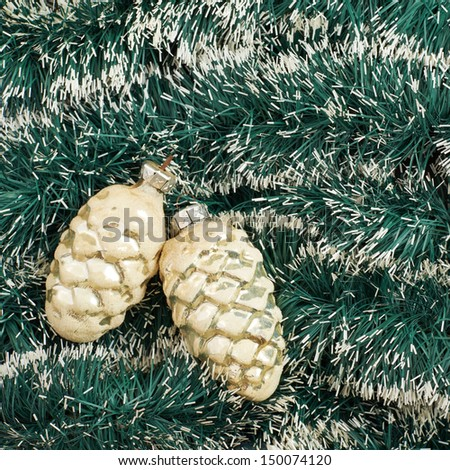 Seasonal Christmas decoration background as an xmas tree garland fragment covered with decorational pine cones