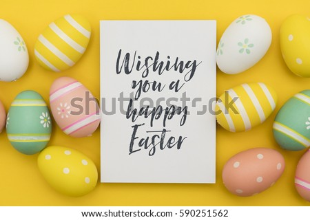 Seasonal Easter message with decorated Easter eggs  #590251562