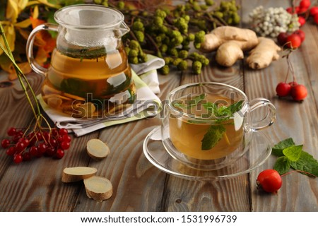 Seasonal, ginger-mint tea, a healthy drink for colds, in late autumn and cold winter. #1531996739