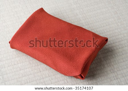 SEASONAL IMAGE-a red wrapping cloth on a Tatami mat