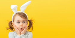 Seasonal sale and discount. Shopping and retail. Preparing for Easter holiday. Promoting goods. Funny, surprise, little child girl in bunny ears. Banner, copy space for text, mock up
