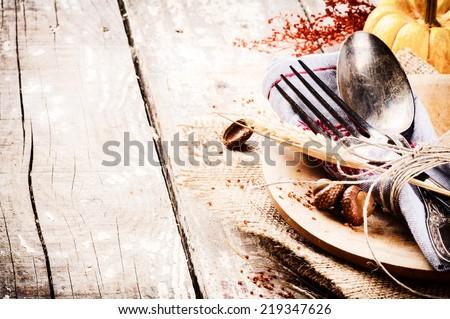 Seasonal table setting with decorative pumpkin
