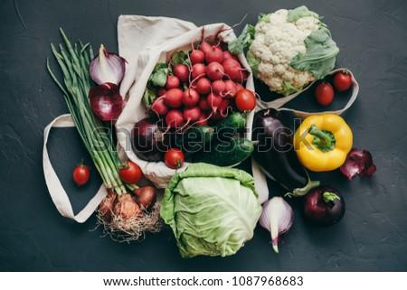 seasonal vegetables radish cabbage onions peppers cucumbers tomatoes dark background #1087968683
