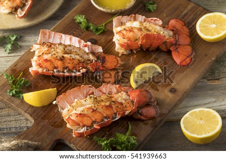 Seasoned Baked Lobster Tails with Lemon and Butter Sauce #541939663