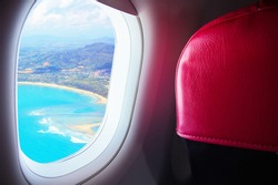 Seat and window airplane With view sea beach blue sunny fly above island - Travel Concept