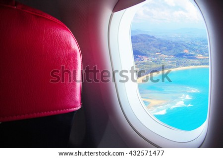 Seat and window airplane With view sea beach blue sunny in Phuket island - Travel Concept