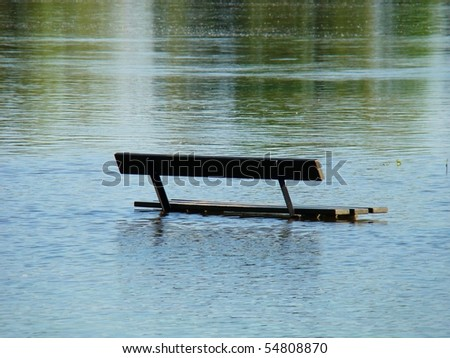 Seat bench in a river with flood water