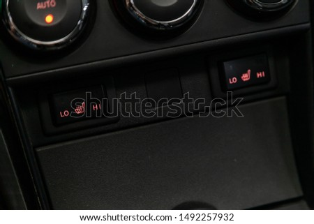 Seat heating indicator in the car included. modern car interior: parts, buttons, knobs