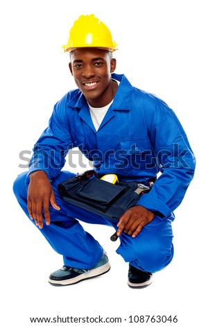 Seated african worker posing with a smile isolated over white background