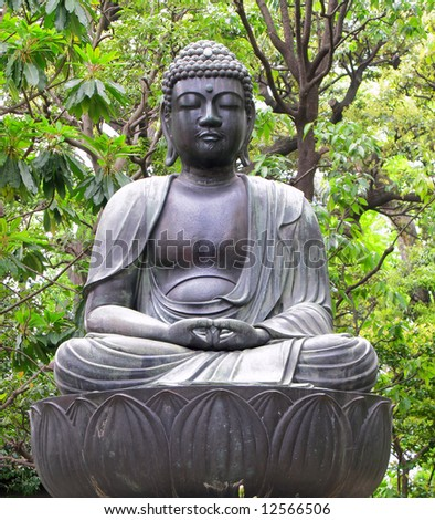 Seated Buddha statue at temple in Tokyo, Japan.
