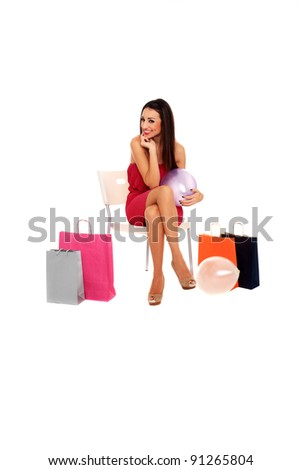 seated girl with balloons and shopping bags isolated on a white background