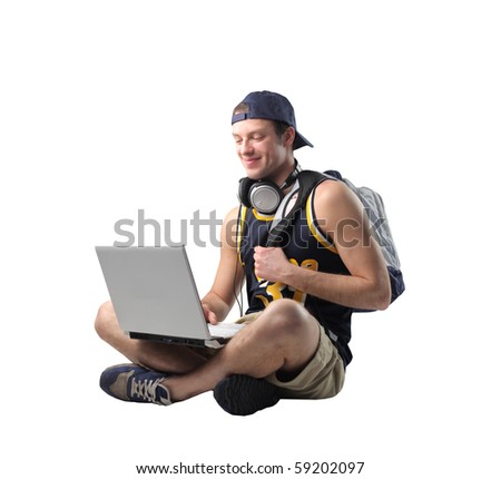 Seated man with laptop on his knees