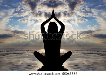 Seated yoga pose. Sunset silhouette.