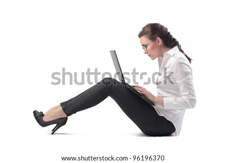 Seated young businesswoman using a laptop