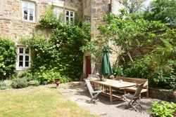Seating area in a cottage garden