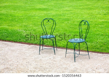 seats with nobody near green grass