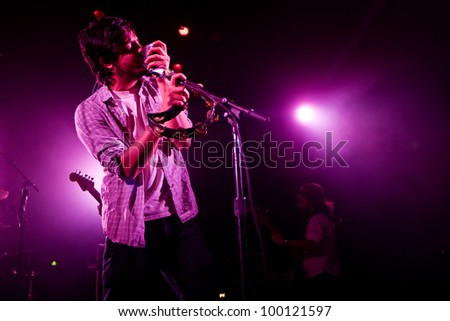 SEATTLE - April 7:  Sameer Gadhia of alternative Indie rock band Young the Giant performs with the group in front of a sold out audience at the Moore Theater in Seattle, Washington on April 7, 2012.