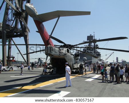 SEATTLE - AUG 4 : Civilians inspect an CH-53E Sea Stallion helicopter,during a tour of the Amphibious Assault Ship Bonhomme Richard, LDH-6,  on Aug 4, 2011, in Seattle.
