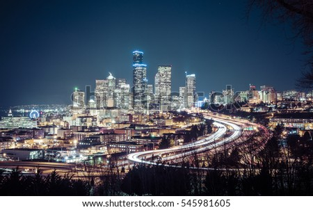 Seattle cityscape at night with traffic light on freeway,Washington,usa. #545981605
