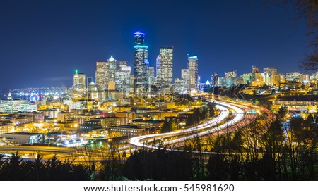 Seattle cityscape at night with traffic light on freeway,Washington,usa. #545981620