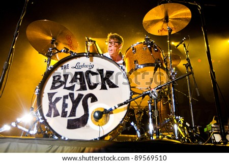 SEATTLE - DECEMBER 8: Drummer Patrick Carney of Indie Rock Band the Black Keys playing the drums live in concert during the Deck the Hall Ball in Seattle, WA on December 8, 2010.