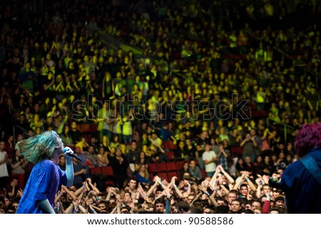 SEATTLE, DECEMBER 7, 2011:  Punk rocker Matt Shultz of rock band Cage the Elephant performs in front of a sold out crowd at Key Arena in Seattle during the Deck the Hall Ball on December 7, 2011.