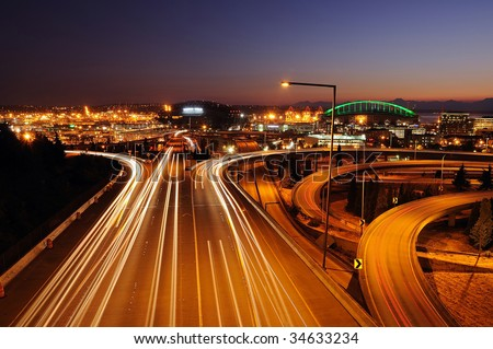 Seattle freeways with colorful streaks of light from fast moving traffic