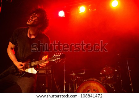 SEATTLE - JULY 21:  Rock guitarist and singer Jordan Cook aka Reignwolf performs on stage at Neumos during the Capitol Hill Block Party in Seattle, WA on July 21, 2012.