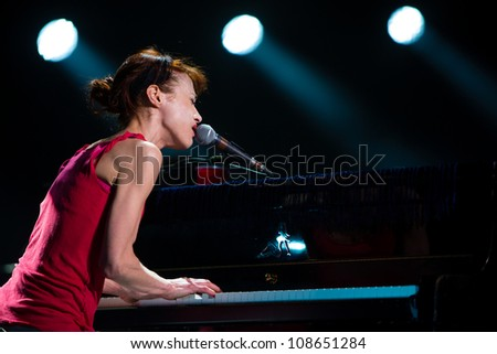 SEATTLE - JULY 25:  Rock singer, songwriter and pianist Fiona Apple performs on stage at the Paramount Theater in Seattle on July 25, 2012. - stock photo