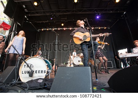 SEATTLE - JULY 25:  Wesley Shultz of the popular folk band the Lumineers performs with Jeremiah Friates and Neyla Pekarek on the main stage at the Capitol Hill Block Party in Seattle on July 22, 2012