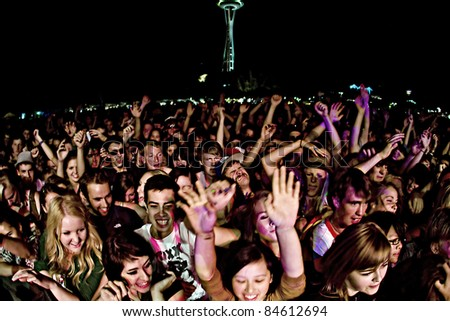SEATTLE - SEPT. 3:  A large crowd of teenagers scream for their favorite band during the Bumbershoot Music Festival in front of the Space Needle in Seattle on September 3, 2011.