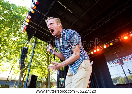 SEATTLE - SEPT. 4:  American Hip Hop artist Astronautalis performs on stage during the Bumbershoot music festival in Seattle, Washington on September 3, 2011.
