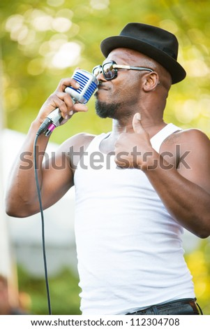 SEATTLE - SEPTEMBER 1:  Lead singer Kelvin Swaby of British Rock Band the Heavy performs on the TuneIn stage during the Bumbershoot music festival in Seattle, WA on September 1, 2012