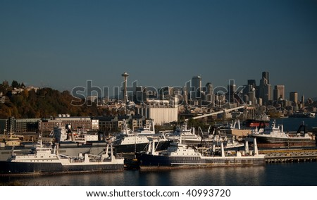 Seattle skyline and seafood ships at dock in the Puget Sound, Washington, USA