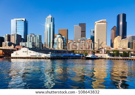 Seattle skyline and waterfront, with beautiful reflections.  Viewed from the water.
