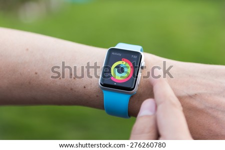 SEATTLE, USA - May 9, 2015: Man Using activity App on Apple Watch to See Calories Burned During Day.
