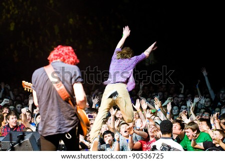 SEATTLE, WA -  DECEMBER 7: Rock Band Cage the Elephant lead singer dives into a sold out crowd at Key Arena during the Deck the Hall Ball in Seattle, WA on December 7, 2011.