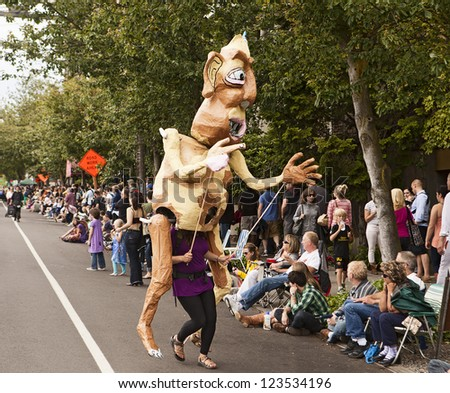 SEATTLE, WA - JUNE 16, 2012: A giant puppet menaces the audience during the 2012 Annual Fremont Summer Solstice Parade in Seattle on June 16, 2012. The parade celebrates the start of summer.