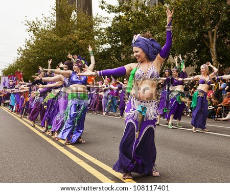 SEATTLE, WA - JUNE 16, 2012: A line of belly dancers in the Silk Road Troupe dance during the Fremont Summer Solstice Day Parade in Seattle on June 16, 2012. The parade celebrates the start of summer.
