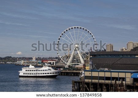 SEATTLE,WA,USA-APRIL17: The Seattle Great Wheel sets off the Seattle skyline on April 17,2013.  The Great Wheel is one of the Largest Ferris Wheels in the USA, built to attract tourists.