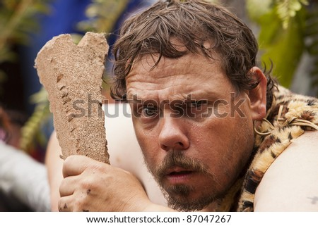 SEATTLE, WASHINGTON - JUNE 18:  An unidentified member of the Caveman Discovers Cannabis ensemble participates in the the annual Fremont Solstice Day Parade on June 18, 2011 in Seattle, Washington. The parade celebrates the start of summer.