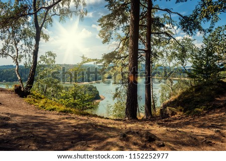 Sec Dam with Path in Forest. Czech Republic, Bohemia, Europe. Summer Landscape with Sun on Blue Sky and Water in Lake. Nature Scene.